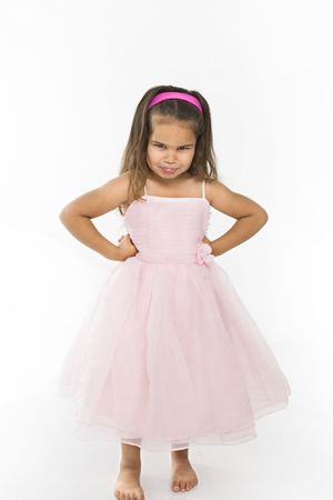 Little hispanic girl wearing pink dress pouting at viewer. Stock Photo - 3569346