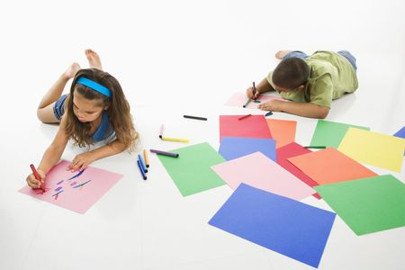 Young latino boy and girl coloring on construction paper and smiling. Stock Photo - 3569363