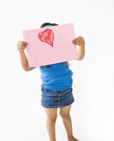 Young girl showing off drawing of heart. photo