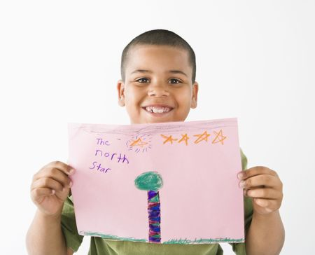 Young boy proudly showing drawing. Stock Photo - 3589219