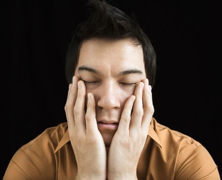 Portrait of Asian young man with hands on face. Stock Photo - 3589435