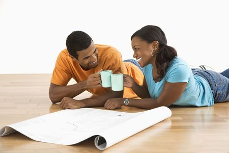 African American couple with architectural blueprints. photo