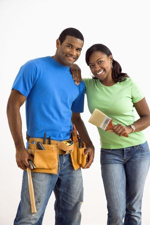 Portrait of African American male and female couple with home repair tools. photo