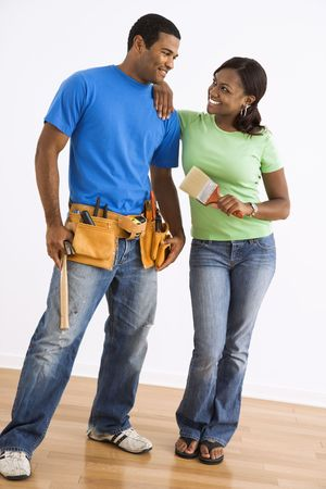 home repair: Portrait of smiling African American male and female couple with home repair tools. Stock Photo