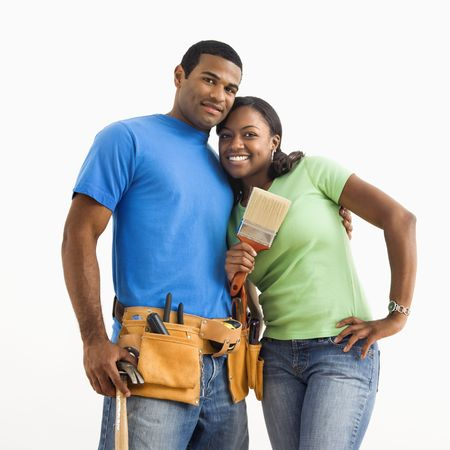 home repair: Portrait of African American male and female couple with home repair tools.