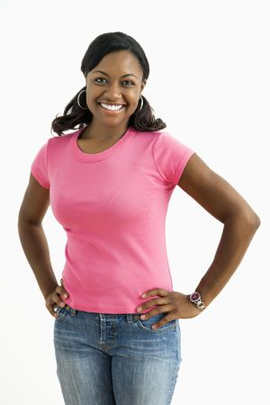 Portrait of smiling African American female standing looking at viewer.