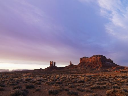 mesas: Scenic landscape at dusk of mesas in Monument Valley near the border of Arizona and Utah, United States.