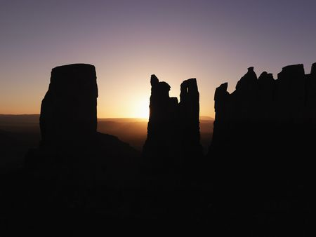 mesas: Scenic sunset landscape of mesas in Monument Valley near the border of Arizona and Utah, United States.