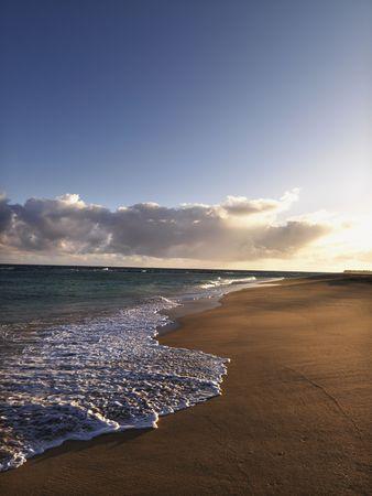 The beach at dusk in Maui, Hawaii.