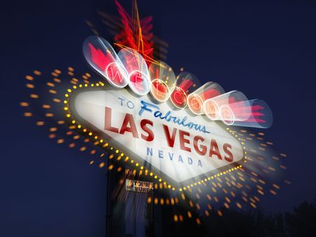 las vegas sign: Welcome to Fabulous Las Vegas Nevada sign with motion zoom blur at night. Horizontally framed shot. Stock Photo
