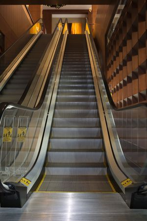 guardrails: Low angle view of escalators in an office building. Vertical shot.
