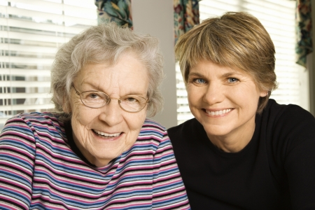 40s adult: Portrait of an adult woman and senior woman smiling at the camera. Horizontal shot.