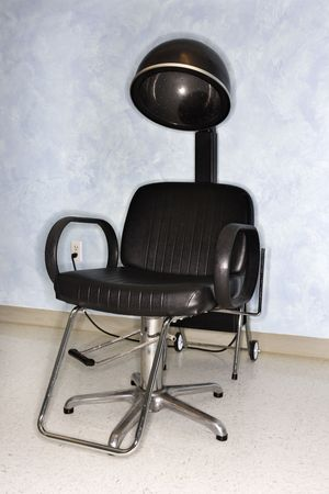 Empty styling chair and hair dryer at a salon.  Vertical shot. Stock Photo - 6272225