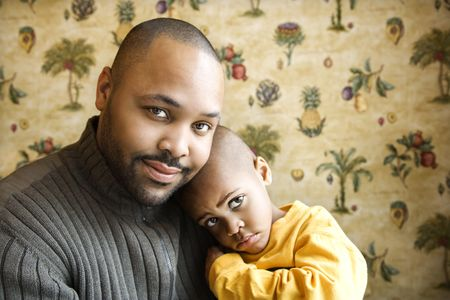 Portrait of african american father holding his young son and looking at viewer.  Horizontal shot. Stock Photo - 6302301
