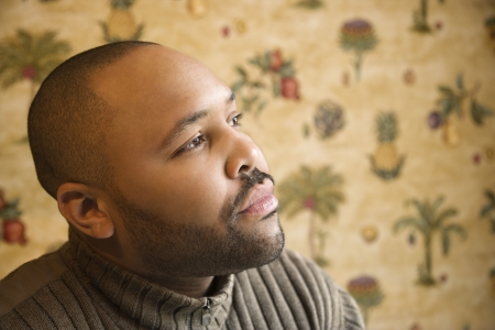 Portrait of contemplative black man looks off to the side.  Horizontal shot. photo
