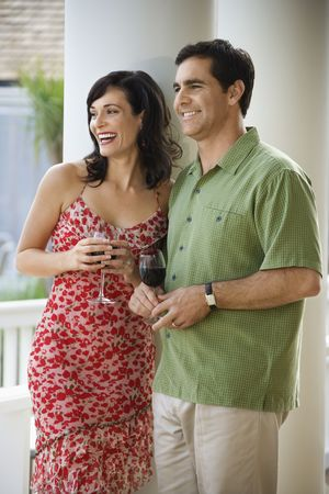 Man and woman stand together with glasses of red wine. Vertical shot. Stock Photo - 6302649
