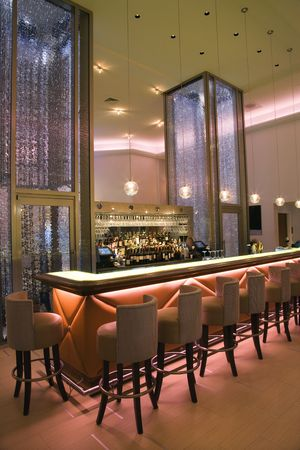 Interior of empty cocktail lounge with elegant lighting. Vertical shot.
