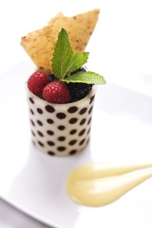 fine dining: Elegant display of a dessert fruit cup with mint leaves. Vertical shot.
