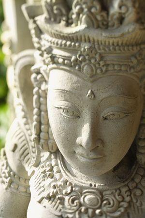 statuary garden: Carved stone statue of the Buddhist Goddess Kuan Yin. Vertical shot.