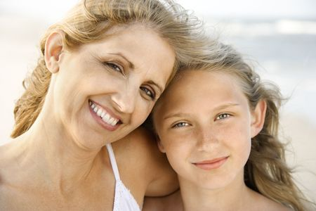 Mother and daughter smile into the camera at the beach. Horizontal shot. Stock Photo - 6455322