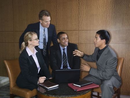 ethnically diverse: Ethnically diverse group of businessmen and a businesswoman having an enjoyable meeting together. Horizontal shot.