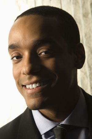 Head and shoulder portrait of smiling African-American mid-adult businessman. photo