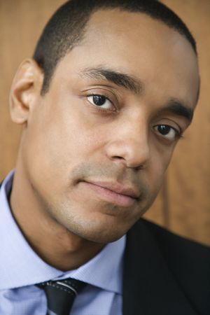 Cropped close-up portrait of African-American mid-adult businessman. Vertical format. Stock Photo - 6455290