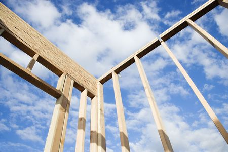 erected: Section of a wall framed out in wood against the blue sky. Horizontal shot. Stock Photo