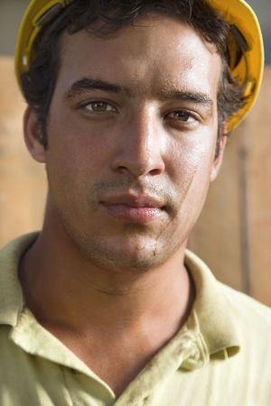 Close up portrait of a male Caucasian construction with a dirty face. He is looking directly into the camera. Vertical shot. Stock Photo - 6455195