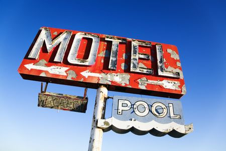 Old weathered retro neon motel sign advertising pool and vacancy. Horizontal shot. photo