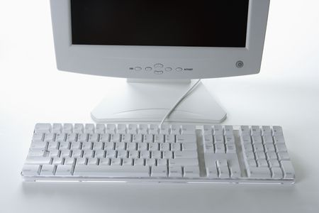 White computer keyboard and monitor on a white table. Horizontal shot. Stock Photo - 6424728