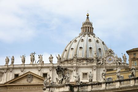 statuary: Statuary and dome of St Peters Basilica. Horizontal shot. Stock Photo
