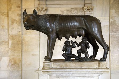 Statue of the Capitoline Wolf showing Remus and Romulus as suckling infants. Horizontal shot.