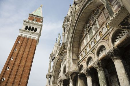 Low angle view of bell tower and facade of St Mark's Basilica. Horizontal shot. Stock Photo - 6428457