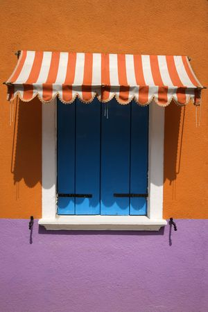 Colorful window with shutters and awning in Venice, Italy. Vertical shot. Stock Photo - 6427339