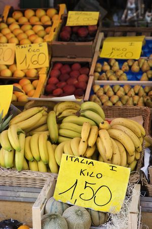 Boxes of bananas and other fruits at a market in Italy. Vertical shot. Stock Photo - 6427333