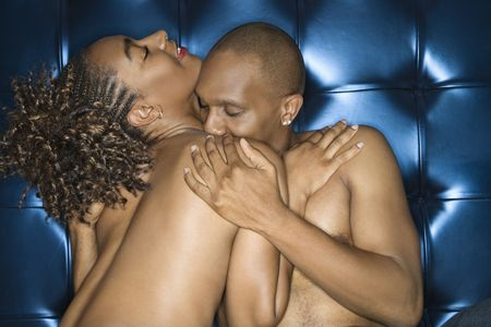 Attractive young shirtless couple in an intimate embrace. Horizontal shot. photo