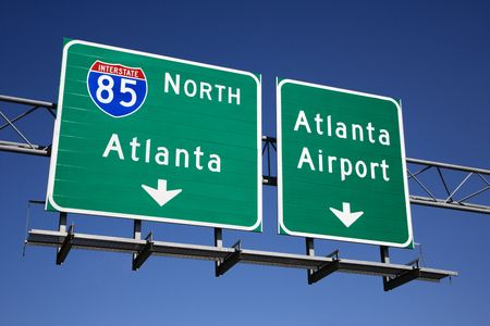 atlanta tourism: Freeway signs directing drivers to the Atlanta airport. Horizontal shot. Stock Photo