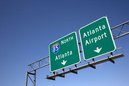 Freeway signs directing drivers to the Atlanta airport. Horizontal shot. Stock Photo