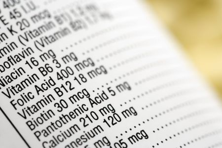 Closeup of a dietary supplement label listing the vitamins contained within each tablet. Horizontal shot. Stock Photo