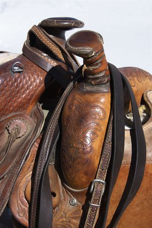 tacks: Closeup of two western horse saddles grouped together. Vertical shot.