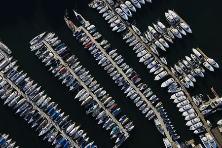 Aerial view of boats lined up on the piers at a marina. Horizontal shot. photo