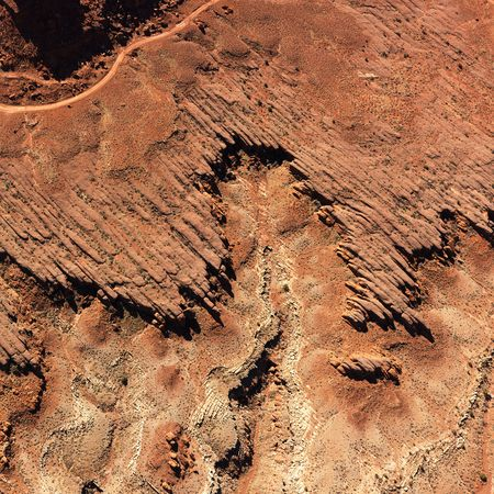 lack of water: Birds eye view of rock formations in a desert environment. Square format.