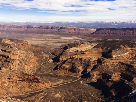 craggy: Aerial view of an arid, craggy landscape with canyons. Horizontal shot.