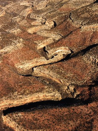 craggy: Aerial view of an arid, craggy landscape. Vertical shot.