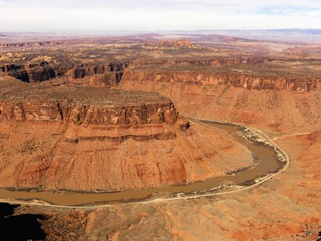 craggy: Aerial view of an arid, craggy landscape with a river running through it. Horizontal shot.