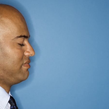 Profile of African American businessman with eyes closed.