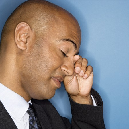 man side view: African American businessman rubbing his eyes. Stock Photo
