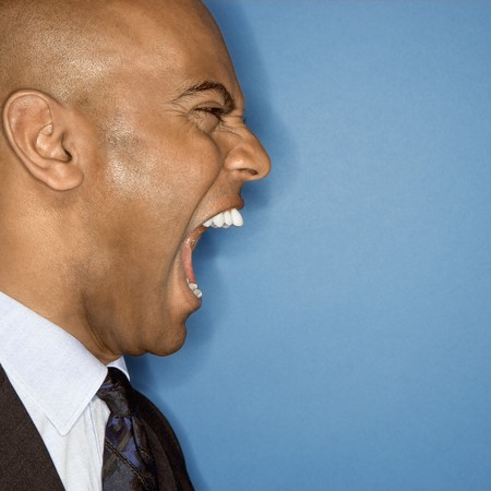 African American businessman screaming.