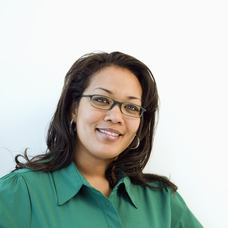 Portrait of pretty African American businesswoman wearing eyeglasses and smiling.